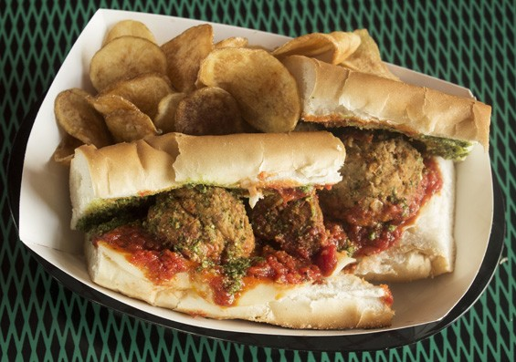 """Meatball"" sandwich with housemade tomato sauce, provolone and basil pesto. 