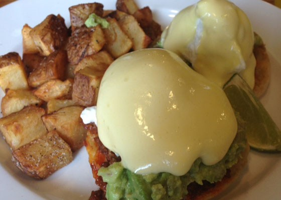 Eggs benedict with avocado and chorizo and breakfast potatoes. | Nancy Stiles