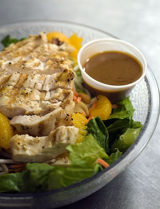 Grilled chicken atop the Thai Chicken Salad, which is comprised of grilled marinated chicken atop crisp romaine, bean sprouts, cashews, mandarin oranges, green onion, carrot and a side of Thai peanut sauce. See more photos here. - PHOTO: JENNIFER SILVERBERG
