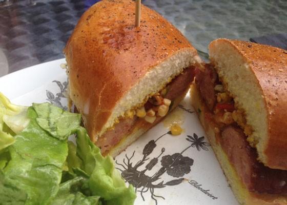 Barbecue pork sausage sandwich with a side salad. | Nancy Stiles