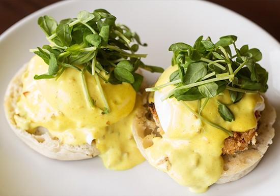 Eggs Benedict special with vegan crabcake and vegan chipotle hollandaise.