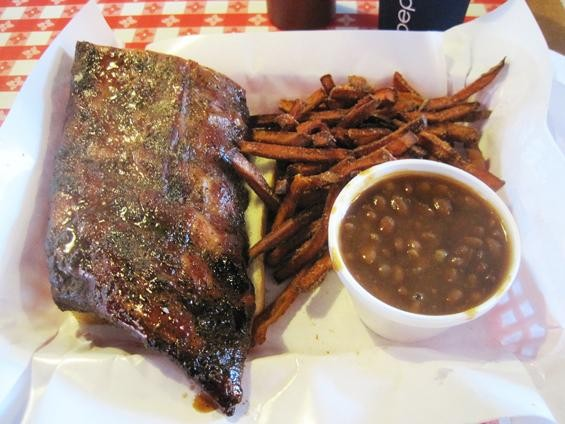 Half a slab of the ribs (with baked beans and sweet-potato fries) at Pappy's Smokehouse - IAN FROEB