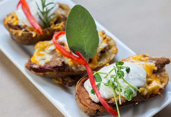 SqWires' stuffed potatoes with smoked brisket, cheddar cheese and horseradish cream.   Photos by Mabel Suen