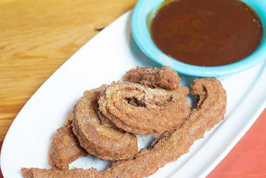 Churros with chocolate sauce for dessert.