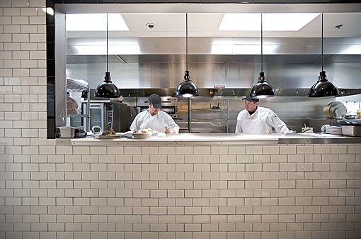 Busy in the kitchen are, on right, grill cook Darren Muse and, on left, sauté cook Lukas Lorance. See a slideshow of Table Three photos here. - PHOTO: JENNIFER SILVERBERG