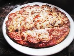 a Mr. X Pizza - IAN FROEB