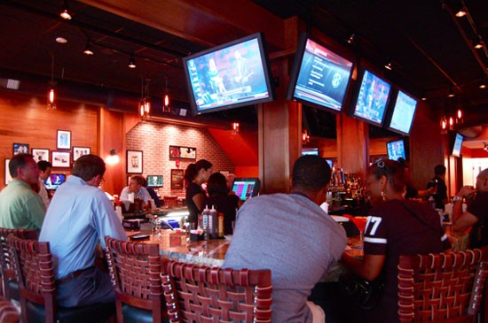 Thirty-seven TVs dot the walls and rooftop patio of Lester's. - ETTIE BERNEKING