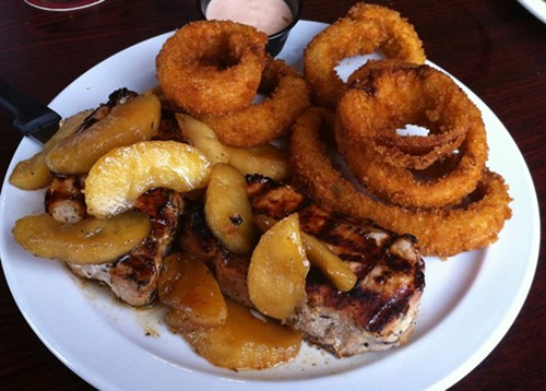 Pork chops with sautéed apples at Quincy Street Bistro. - HOLLY FANN