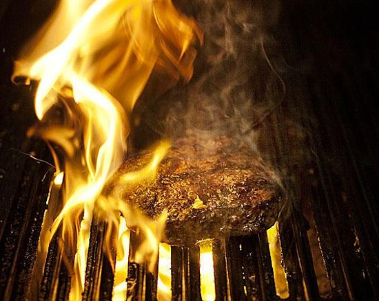 A patty on the grill at Dave & Tony's Premium Burger Joint - JENNIFER SILVERBERG