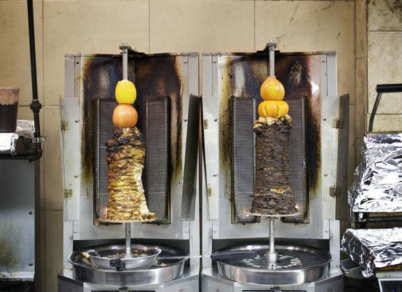 The meat (right) and chicken shawarma on the spit at the Vine Mediterranean Cafe & Market - JENNIFER SILVERBERG