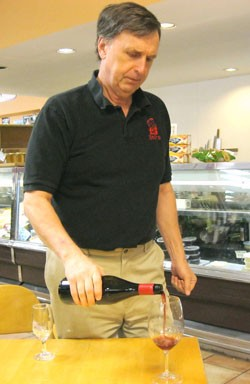 Bud Starr of Starr Wines measures us a glass of Parker Station pinot noir. - ERIKA MILLER