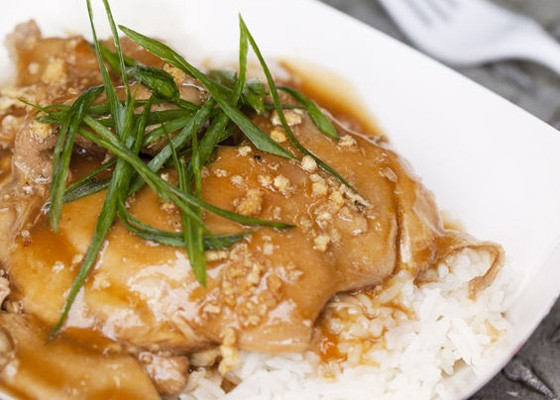 Chicken Adobo with soy sauce and vinegar braised chicken thighs served over steamed jasmine rice with green onions. | Jennifer Silverberg