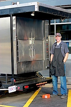 "Co-owner Matt Stiffelman and his ""showy"" smoker. - KAITLIN STEINBERG"