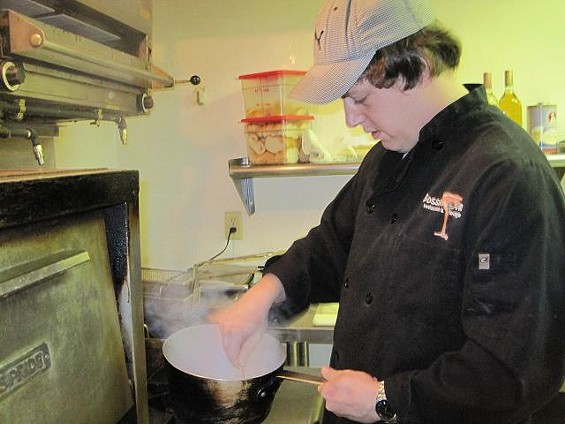 Putnam at work in the Bossanova kitchen. - ROBIN WHEELER