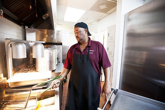 Owner Charles Butler in the Lil' Mickey's kitchen - JENNIFER SILVERBERG
