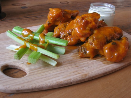 Peach habenero wings with celery and ranch at the Fifth Wheel. - ALICE TELIOS