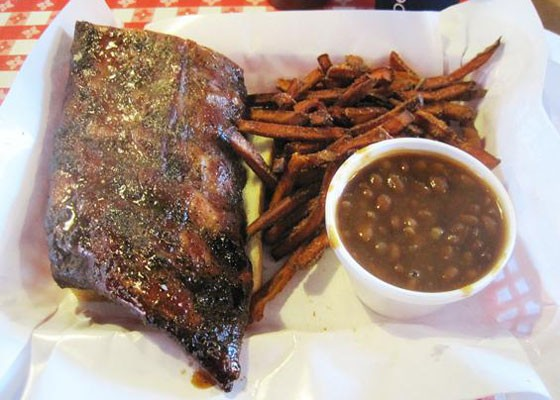Half a slab of ribs, baked beans and sweet potato fries at Pappy's. | Ian Froeb
