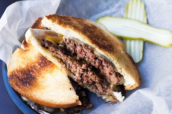 """""""Bobby's Melt,"""" two four-ounce beef patties topped with cheddar, swiss and thousand island. 