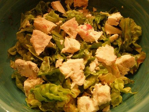 Greens with cheese brick (shattered) and French dressing (Kraft red-style). - ROBIN WHEELER