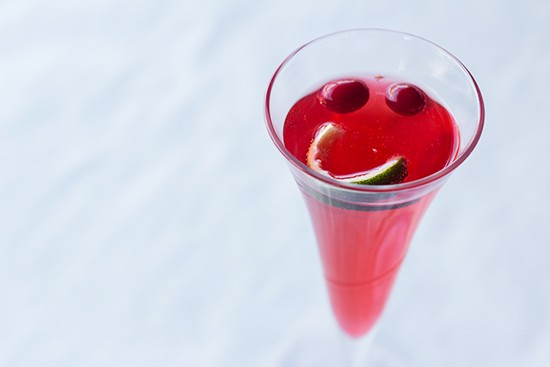 """""""Cranberry Fizz"""" Champagne cocktail with cranberry juice, squeezed lime juice and Champagne."""