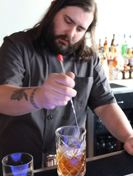 Eclipse bar manager Tony Saputo stirs Gut Check up a cocktail. - EVAN C. JONES
