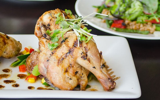 Grilled Cornish hen with oven-roasted potatoes and leeks with black bean succotash. | Bixby's