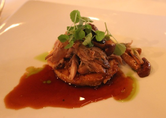"""Duck confit with black olives and wild mushrooms on toasted polenta with Caymus reduction sauce, which was paired with the 2012 Belle Glos """"Clark & Telephone"""" Pinot Noir. 