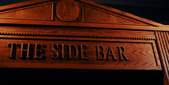 The mantel over the bar at the Side Bar. - CAILLIN MURRAY