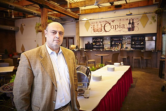 Amer Hawatmeh, general manager of Copia Restaurant & Wine Garden, feels Ballpark Village should have brought more people downtown instead of stealing business from local restaurants and bars. - STEVE TRUESDELL