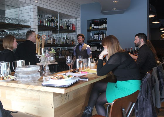 The Libertine team enjoys family meal before the night's service. | Nancy Stiles