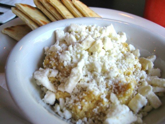 House-made hummus served with warmed pita, feta cheese and scallions at MoKaBe's. - REASE KIRCHNER