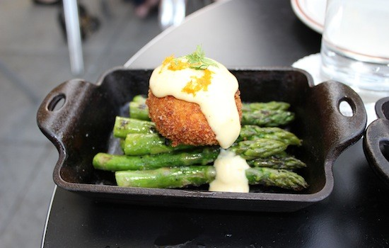 Grilled local asparagus with a crisp poached egg and orange aioli at Taste | Ian Froeb