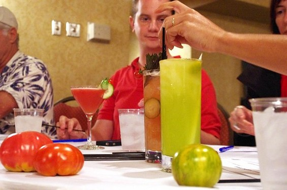 Evan Benn of the St. Louis Post-Dispatch evaluates cocktails from (left to right) Nate Selsor, Matt Seiter and Kilgore. - ALISSA NELSON