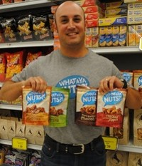 Howie Sher stands with his new snack food, What-A-Ya Nuts?! Sher was pleased to see that a Schnucks location had almost sold out of the product after Labor Day weekend. - JULIA GABBERT