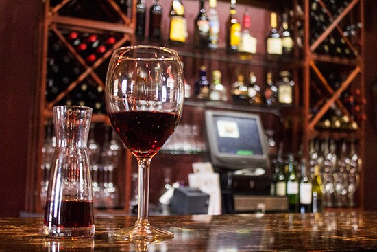 A glass of red wine.