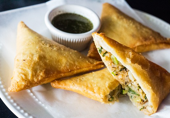 Flaky samosas stuffed with veggies and served with tzatziki. | Photos by Mabel Suen