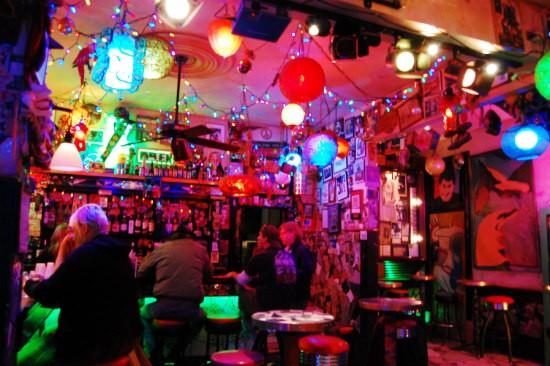 Regulars relax at the bar at the Venice Café. - CAILLIN MURRAY