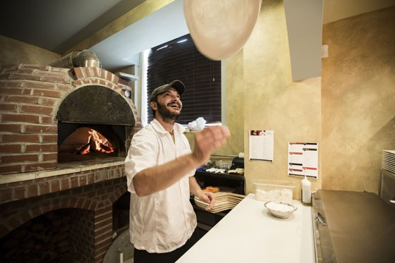 Chef Ivan Malinov making a pizza at Pizzeria Mia. | Jennifer Silverberg