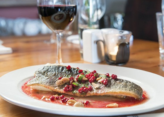 The trout, with Marcona almond, lingonberry, herbs and horseradish flan at Three Flags Tavern. | Corey Woodruff