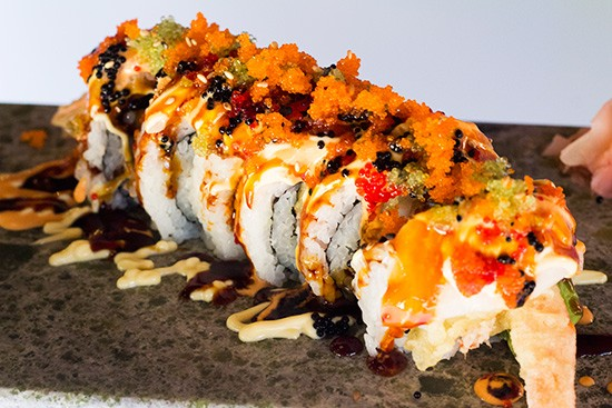 "Sushi House's ""White Tiger"" roll with deep-fried shrimp, crab, asparagus, avocado and white tuna. 