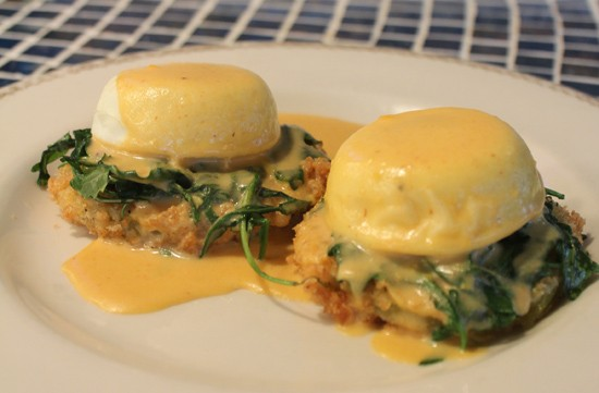 Eggs benedict served atop fried green tomatoes at Plush - MABEL SUEN