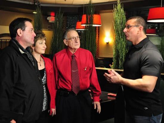 Robert Irvine pumps up John Meglio (left) on Restaurant: Impossible - FOOD NETWORK