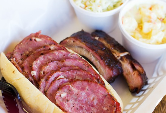 A smoked salami sandwich with a sampling of ribs, potato salad and coleslaw. - MABEL SUEN