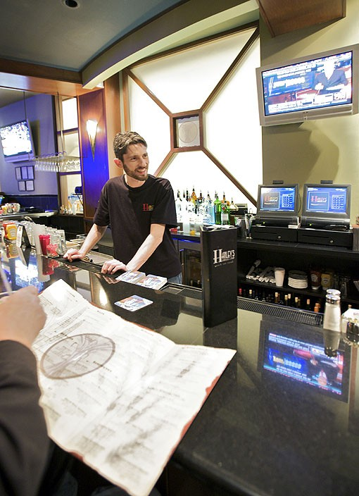 Jacob Baker, bartender at Hanley's Grill & Tap. See more photos from inside Hanley's in this slideshow. - PHOTO: JENNIFER SILVERBERG