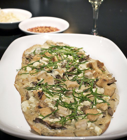 One of four flatbreads on the menu, the White chicken flatbread is served with grilled rosemary chicken, wild mushrooms, spinach and Feta cheese. See more photos from inside Hanley's in this slideshow. - PHOTO: JENNIFER SILVERBERG