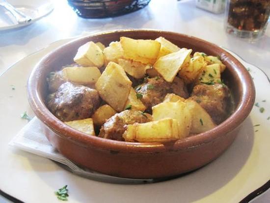 Albóndigas caseras with patatas bravas at Guido's Pizzeria & Tapas - IAN FROEB