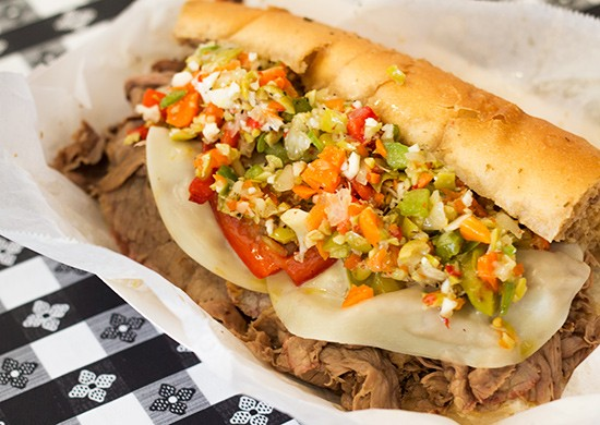 Italian beef sandwich with thinly sliced beef, cheese, peppers and onions topped with giardiniera. | Photos by Mabel Suen