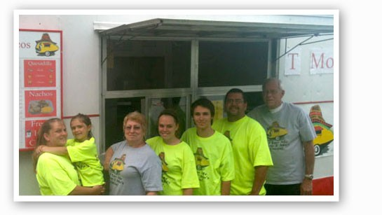 The Morales family in front of T Mo's Tacos. Left to right: wife Michelle Morales,daughter Jada Morales, mother-in-law Judy Myers, daughter Michaela Morales,son Jordon Myers, Todd Morales and father-in-law Larry Myers.   Todd Morales