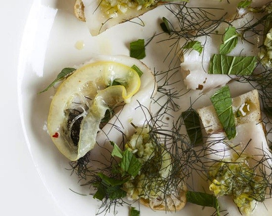Mangalitza Lardo on focaccia with sott'aceto (pickled fennel and celery relish) and herbs. - JENNIFER SILVERBERG