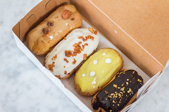 """Miniature versions of Simone Faure's spring eclair line: iced coffee, maple bacon, lemon meringue and """"Gold Digger."""" - PHOTOS BY MABEL SUEN"""